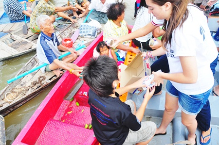 Francesca and Dominic distribute food packets to the local people.