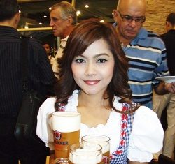A lovely Kellnerin serves up ample amounts of Paulaner beer.