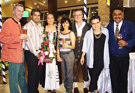 Tony Malhotra (2nd left), sales and marketing manager of Pattaya Mail Media Group, presents a flower bouquet to Kanpitcha Kongsombat (3rd left), executive director of Danmark Co., Ltd., on the grand opening of Paulanergarten. Also on hand were (from left) Ingo Räuber, general manager Pinnacle Resorts, Sue K., director of communication Pattaya Mail TV, Kenneth Whitty, managing director of Danmark Co., Ltd., Earth Saiswang, director PR and communication Oasis Spa, and Peter Malhotra, managing director of Pattaya Mail Media group.