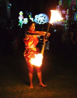 The bamboo fire dances eerily light up the night at Horseshoe Point.