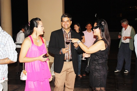 Som Corness (left) and Rungratree Thongsai (right) share a laugh before the dinner while Tony Malhotra (center) only worries about his wine.