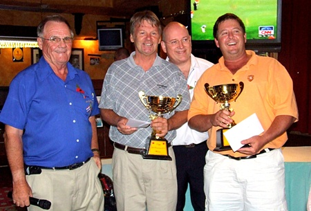 The tournament winners, Steve Hamstad and Jeff Warner, collect their trophies.