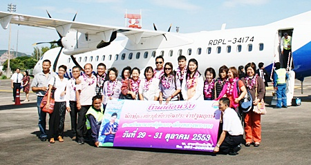 History being made - passengers prepare to board Laos Airlines flight QV410 from U-Tapao to Luang Prabang in Laos, becoming the first to do so.