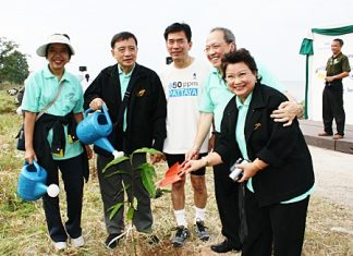 "Chatchawal Supachayanont (2nd right), general manager of Dusit Thani Pattaya is seen with Dr. Jiraphol Sindhunava (middle), vice-president of the Green Leaf Foundation and other officials after planting a young tree during the ""We Care for Trees"" campaign."