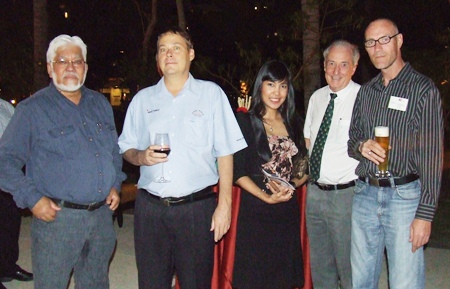 L to R)  Tulshi Sen, president of Tulshi Sen Consulting Omnisun Systems Inc.; Randy Simmons, director of CHS-ASIA Co., Ltd.; Chutima Konfai, director of sales for Holiday Inn Pattaya; Dr. Iain Corness; and Amin Walter.