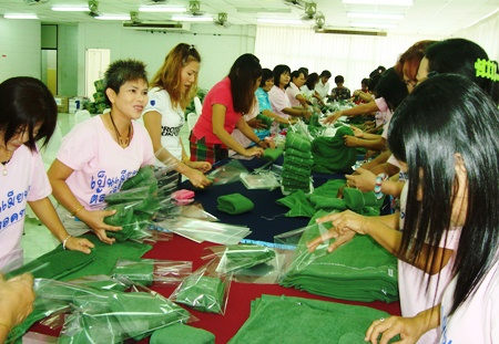 Royal Thai Marines' wives wrap presents for their husbands stationed in the South.