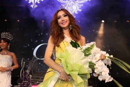 South Korean Minnie Han parades around the stage after winning the Miss International Queen 2010 title.