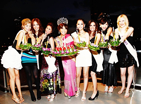 Haruna Ai, Miss International Queen 2009 poses with seven of the 23 Miss International Queen 2010 contestants from 15 countries during Loy Krathong.