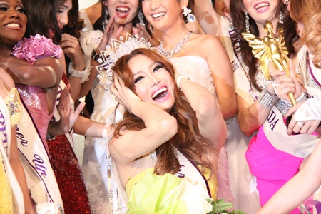 Minnie Han cries out with delight after being crowned Miss International Queen 2010.