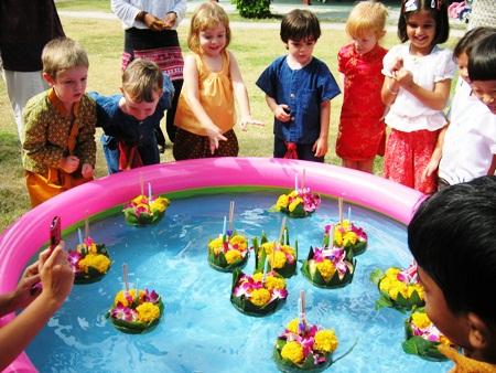 International School of Chonburi students release their krathongs in the school's play pool.