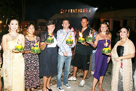 Guests gather to float their krathongs at the Dusit Thani Pattaya Hotel.