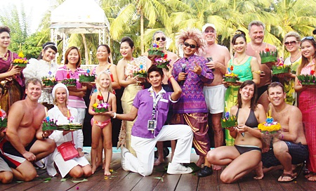 Staff and guests gather by the pool to loy their krathongs at the Hard Rock Hotel.