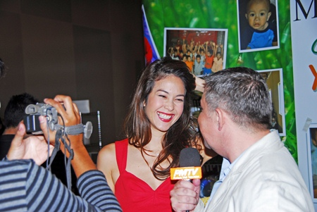 Paula Taylor beams her beautiful smile during an interview with Paul Strachan for Pattaya Mail TV.