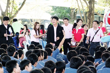 Chonburi Gov. Wichit Chatpaisit and friends distribute free condoms.