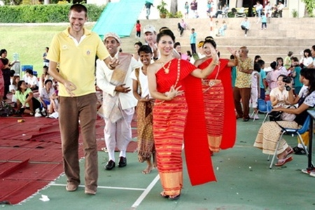 Year 6 teacher James Watkins enjoys demonstrating his own style of Thai dance.