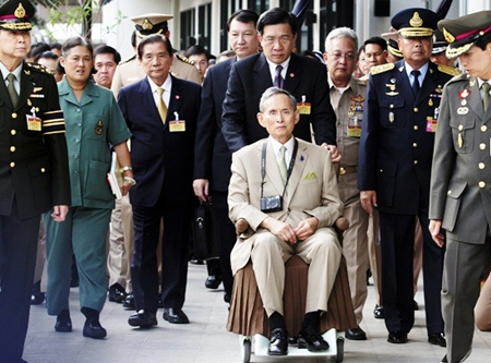 HM King Bhumibol Adulyadej is wheeled towards his yacht in a rare public appearance Wednesday Nov. 24, 2010 to open a new flood gate and two bridges in Bangkok. (AP Photo)