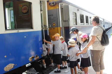 Children climb aboard the train in Pattaya.
