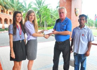 The Service Group presents Dr. Philippe with 7,000 baht to help him provide anti-retroviral drugs for his many patients in and around Pattaya.