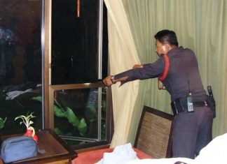 The investigating officer inspects the area where the thieves broke in.