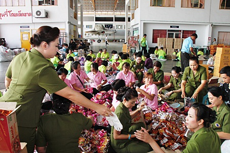 Volunteers help pack bags of relief supplies to send to flood stricken areas throughout Thailand.