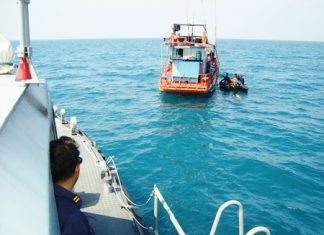 Navy divers search for the body of Sattahip Naval Base employee Suthisak Nundee.