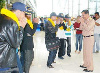 Thai fishermen rescued off the Yemen coast by a Sattahip-based Royal Thai Navy ship arrive at Suvarnabhumi International Airport Nov. 22.