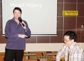 PCEC member Gavin Waddell, also international marketing executive for Phyathai Sriracha Hospital, introduces the guest speaker Dr. Wirote Jiamsiri, M.D., a neurosurgeon from the hospital, to talk about head injuries.