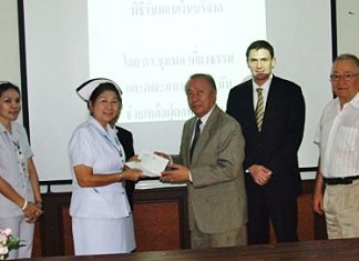 (L to R) Banglamung Hospital Nursing Chief Thepin Inket receives donated funds from Chumpol Thiengtham of the German Benevolent Society of Thailand, Mark Sonntag, managing director Euro Thai Media Co., Ltd, and Horst Schumn.