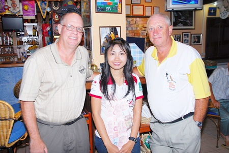 Tuesday's winners, Brian Gabe (golfer of the month), left, and Tony Scambler, right, with Nim on her last day at Bert's.