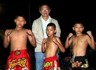 The three young boxing stars strike a pose.