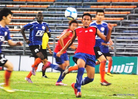 Pattaya United U-19's (red shirts) take on Thai Port Authority U-19's at the Pat Stadium in Bangkok on Thursday, Dec. 2.