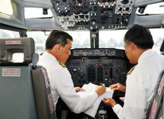 His Royal Highness Crown Prince Maha Vajiralongkorn goes through pre-flight preparations before takeoff.