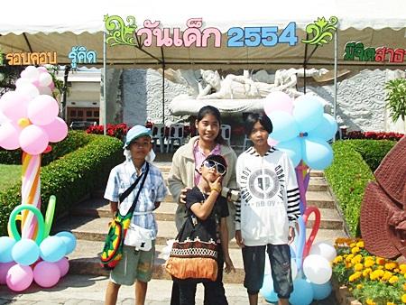 Hamming for the camera at Mini Siam.
