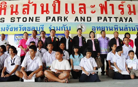Officials at the Crocodile Farm give away 100 scholarships, each worth 1,000 baht.
