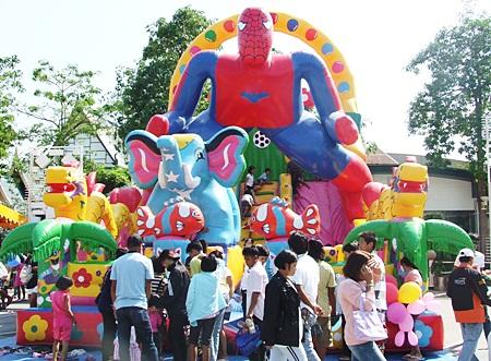 Kids enjoy the bouncy castle at Alcazar.