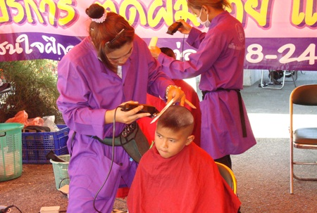 Youngsters are given free hair cuts at Alcazar.