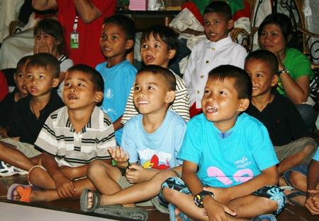 The children enjoy the magic show.