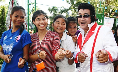 The girls from the Pattaya Orphanage are happy to meet Elvis.