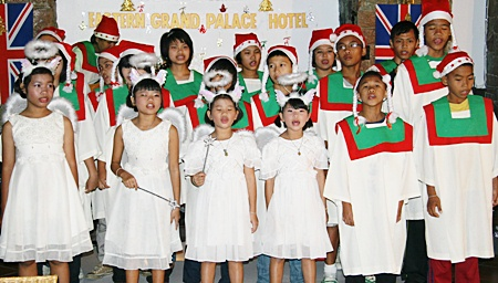 Children from the Father Ray Children's Home sing carols.