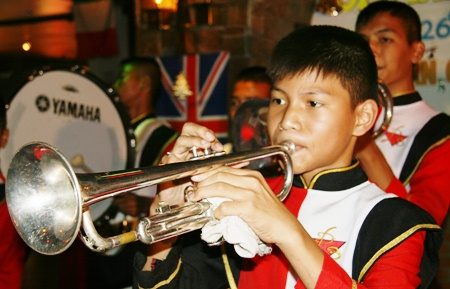 The marching band from Pattaya School No. 3 entertains the children.