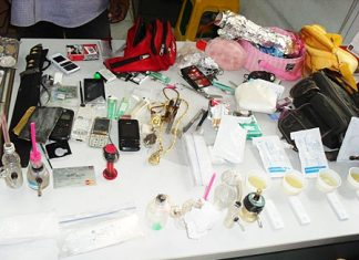 Investigators seized a pink Fino, 21 ya ba tablets, a small pack of marijuana, more than 51,000 baht in cash, gold necklace, mobile phone, knife and drug paraphernalia.