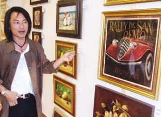 Theerapat Theerakunpaisal shows off his masterpieces.