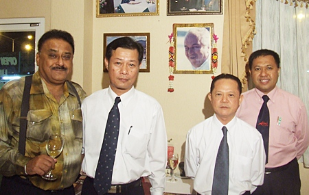 (L to R) Peter proposes a toast as Veerapong, Vichai and Paiboon, the faithful trio stand before photographs of their mentors Louis and Bruno. A glass of Louis' favourite wine was placed in front of his portrait.