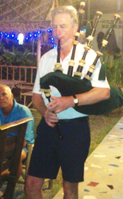 Jim Tait plays the bagpipes in memory of the recently departed Roger Kidd.