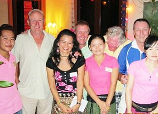 Tuesday's flight winners and runners up pose with the staff at the Relax Bar.