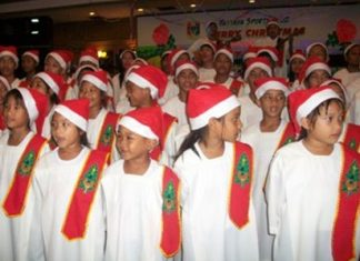 The Pattaya Orphanage choir warm up for the Christmas carols.