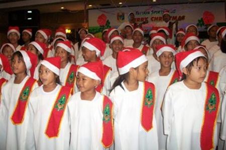The Pattaya Orphanage choir warm up for the Christmas carols.