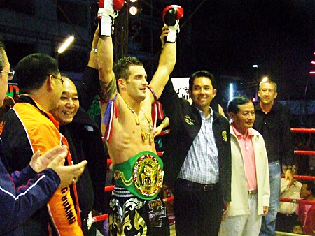 England's Steve Wakeling has his arms raised by Pattaya Mayor Ittiphol Khunplome, right, and Gen. Kovid Bhakdibhumi, left, after being presented with the WBC belt.