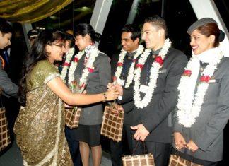 Etihad Airways cabin crew operating Etihad's inaugural flight from Abu Dhabi to Bangalore being welcomed by airport authorities at Bengaluru International Airport on January 2, 2011.
