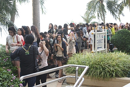 Left, the Korean superstars' fan clubs were waiting to cheer their heroes.
